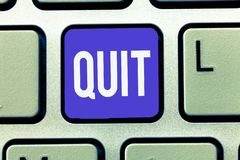 Text sign showing Quit. Conceptual photo Resigning from a job Discontinue the action Stop the activity.  royalty free stock image
