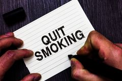 Text sign showing Quit Smoking. Conceptual photo Discontinuing or stopping the use of tobacco addiction Man holding marker noteboo royalty free stock photos