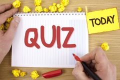 Text sign showing Quiz. Conceptual photo Short Tests Evaluation Examination to quantify your knowledge written by Man on Notepad h. Text sign showing Quiz Royalty Free Stock Image