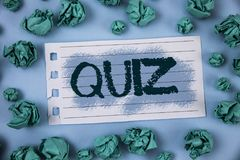 Text sign showing Quiz. Conceptual photo Short Tests Evaluation Examination to quantify your knowledge written on Notepad Paper wi. Text sign showing Quiz Stock Photos
