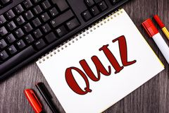 Text sign showing Quiz. Conceptual photo Short Tests Evaluation Examination to quantify your knowledge written on Notepad on woode. Text sign showing Quiz Royalty Free Stock Photo
