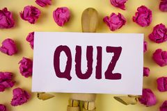 Text sign showing Quiz. Conceptual photo Short Tests Evaluation Examination to quantify your knowledge written on Sticky Note pape. Text sign showing Quiz Stock Photo