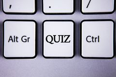 Text sign showing Quiz. Conceptual photo Short Tests Evaluation Examination to quantify your knowledge written on White Keyboard K. Text sign showing Quiz Stock Photos