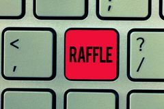 Text sign showing Raffle. Conceptual photo means of raising money by selling numbered tickets offer as prize.  stock photos