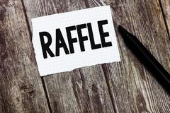 Text sign showing Raffle. Conceptual photo means of raising money by selling numbered tickets offer as prize.  royalty free stock image