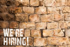 Text sign showing We Re Hiring. Conceptual photo recently employ someone or pay someone to do particular job Brick Wall. Text sign showing We Re Hiring. Business royalty free stock images