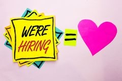Text sign showing We're Hiring. Conceptual photo Recruiting Hiring Now Recruitment Vacancy Announced Hire written on Yellow Stick. Text sign showing We're Hiring royalty free stock images