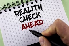 Text sign showing Reality Check Ahead. Conceptual photo Unveil truth knowing actuality avoid being sceptical written by Man on Not. Text sign showing Reality stock photos