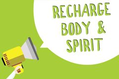 Text sign showing Recharge BodyandSpirit. Conceptual photo fill your energy through relaxation and having fun Multiline text messa. Ge idea convey report sound Royalty Free Stock Images