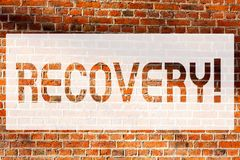 Text sign showing Recovery. Conceptual photo Return to normal state of health Regain possession or control Brick Wall art like royalty free stock photos