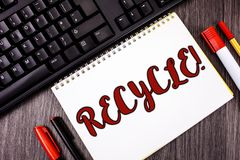 Text sign showing Recycle Motivational Call. Conceptual photo Convderting waste into reusable material written on Notepad on woode. Text sign showing Recycle Royalty Free Stock Photo