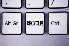 Text sign showing Recycle Motivational Call. Conceptual photo Convderting waste into reusable material written on White Keyboard K. Text sign showing Recycle Royalty Free Stock Photo
