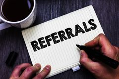 Text sign showing Referrals. Conceptual photo Act of referring someone or something for consultation review Black coffee white cup. Paper marker pen thoughts royalty free stock photo