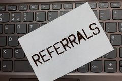 Text sign showing Referrals. Conceptual photo Act of referring someone or something for consultation review Black laptop keyboard. Art paper nice computer stock photography