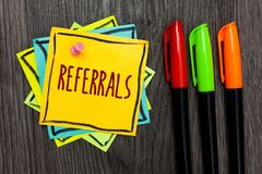 Text sign showing Referrals. Conceptual photo Act of referring someone or something for consultation review Three marker pens four. Small art papers important stock image