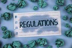 Text sign showing Regulations. Conceptual photo Rules Laws Corporate Standards Policies Security Statements written on Notepad Pap. Text sign showing Regulations Stock Photography