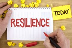 Text sign showing Resilience. Conceptual photo Capacity to recover quickly from difficulties Persistence written by Man on Notepad. Text sign showing Resilience Stock Images