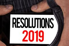 Text sign showing Resolutions 2019. Conceptual photo Positive reinforcement personal improvent corporate goals written on Mobile S. Text sign showing Resolutions Royalty Free Stock Images