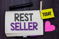 Text sign showing Rest Seller. Conceptual photo one feature or the perceived benefit good which makes it unique Open notebook clot. Hespin holding reminder stock images