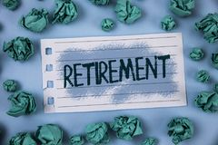 Text sign showing Retirement. Conceptual photo Leaving Job Stop Ceasing to Work after reaching some age written on Notepad Paper w. Text sign showing Retirement Royalty Free Stock Image