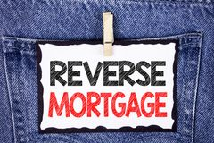 Text sign showing Reverse Mortgage. Conceptual photo Elderly homeowner retirement option regular payment benefit written on White. Text sign showing Reverse Stock Image