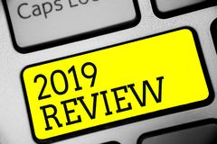 Text sign showing 2019 Review. Conceptual photo seeing important events or actions that made previous year Keyboard yellow key Int. Ention create computer Royalty Free Stock Photo