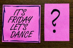 Text sign showing It s is Friday Let s is Dance. Conceptual photo Celebrate starting the weekend Go party Disco Music. Violet color black lined sticky note with royalty free stock photo