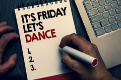 Text sign showing It s is Friday Let s is Dance. Conceptual photo Celebrate starting the weekend Go party Disco Music Written word. S and number on notepad man royalty free stock photography