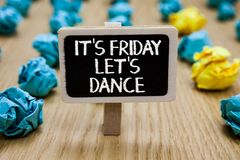 Text sign showing It s is Friday Let s is Dance. Conceptual photo Celebrate starting the weekend Go party Disco Music Paperclip ho. Ld written chalkboard behind royalty free stock photo