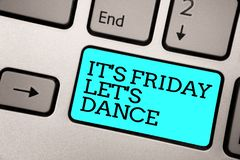 Text sign showing It s is Friday Let s is Dance. Conceptual photo Celebrate starting the weekend Go party Disco Music Silver grey. Computer keyboard with blue royalty free stock image