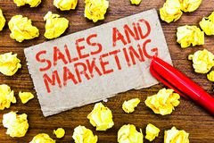 Text sign showing Sales And Marketing. Conceptual photo Promotion Selling Distribution of Goods or Services.  stock photos