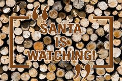 Text sign showing Santa Is Watching. Conceptual photo deliver presents like toys to all well behaved children Wooden stock image