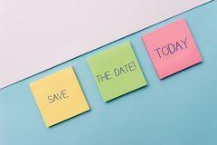 Text sign showing Save The Date. Conceptual photo remember not schedule anything else on this day Pastel colour note royalty free stock photo