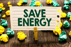 Text sign showing Save Energy. Conceptual photo decreasing the amount of power used achieving a similar outcome Clothespin holding stock photography
