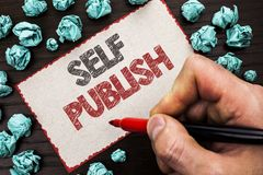 Text sign showing Self Publish. Conceptual photo Publication Write Journalism Manuscript Article Facts written by Man Holding Mark. Er Cardboard Piece the wooden Royalty Free Stock Images