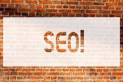 Text sign showing Seo. Conceptual photo Search Engine Optimization Marketing Keywording Brick Wall art like Graffiti motivational. Call written on the wall stock photography