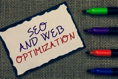 Text sign showing Seo And Web Optimization. Conceptual photo Search Engine Keywording Marketing Strategies Blue bordered page draw. N some texts laid color pen royalty free stock photography