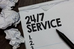 Text sign showing 24 7 Service. Conceptual photo Always available to serve Runs constantly without disruption Marker over notebook. Crumpled papers ripped pages royalty free stock photography