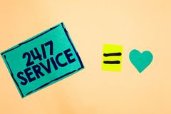 Text sign showing 24 7 Service. Conceptual photo Always available to serve Runs constantly without disruption Turquoise piece pape. R reminder equal sign heart royalty free stock photos