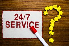Text sign showing 24 7 Service. Conceptual photo Always available to serve Runs constantly without disruption White paper marker c. Rumpled papers forming stock images