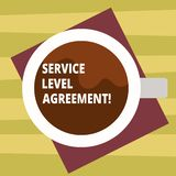 Text sign showing Service Level Agreement. Conceptual photo Commitment between a service provider and a client Top View royalty free illustration