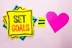 Text sign showing Set Goals. Conceptual photo Target Planning Vision Dreams Goal Idea Aim Target Motivation written on Stacked Sti. Text sign showing Set Goals Stock Photos