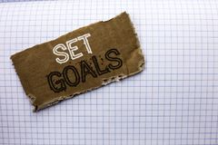 Text sign showing Set Goals. Conceptual photo Target Planning Vision Dreams Goal Idea Aim Target Motivation written on tear Cardbo. Text sign showing Set Goals Stock Photography