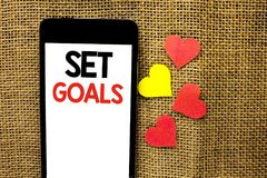 Text sign showing Set Goals. Conceptual photo Target Planning Vision Dreams Goal Idea Aim Target Motivation written on Cardboard P. Text sign showing Set Goals Royalty Free Stock Photo