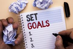 Text sign showing Set Goals. Conceptual photo Target Planning Vision Dreams Goal Idea Aim Target Motivation written by Man on Note. Text sign showing Set Goals Royalty Free Stock Photography