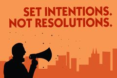 Text sign showing Set Intentions. Not Resolutions.. Conceptual photo Positive choices for new start achieve goals Man holding mega vector illustration