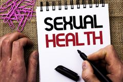 Text sign showing Sexual Health. Conceptual photo STD prevention Use Protection Healthy Habits Sex Care written by Man Holding Mar. Ker Notebook Book the jute royalty free stock photos