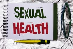 Text sign showing Sexual Health. Conceptual photo STD prevention Use Protection Healthy Habits Sex Care written on Notebook Book o. Text sign showing Sexual stock photos