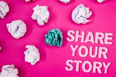 Text sign showing Share Your Story. Conceptual photo Experience Storytelling Nostalgia Thoughts Memory Personal Text Words pink ba. Ckground crumbled paper notes stock image