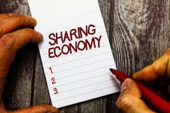 Text sign showing Sharing Economy. Conceptual photo economic model based on providing access to goods.  stock image